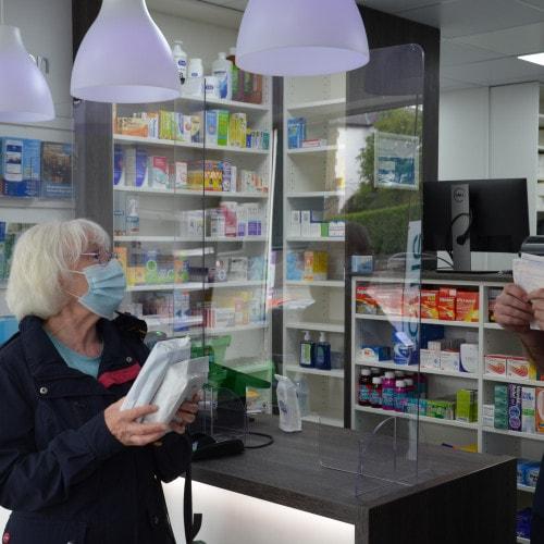 Stephen & Patient Collecting Prescription